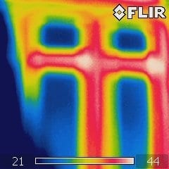 red and white thermal imaging picture of heat loss from a thermal imaging inspection